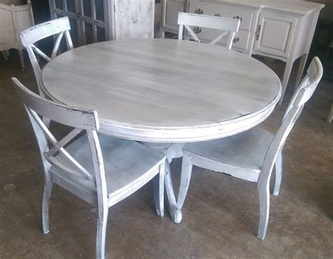 grey and white dining table here is a 54 quot round table and four chairs i painted it