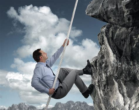 businessman climbing mountain stock images image