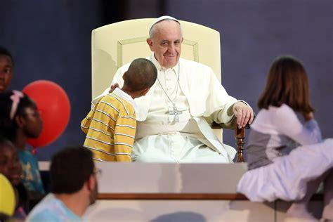 Boy Hugs Pope Francis During Speech