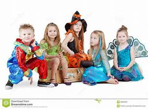 Children In Carnival Costumes Sit On Chest Stock Image ...