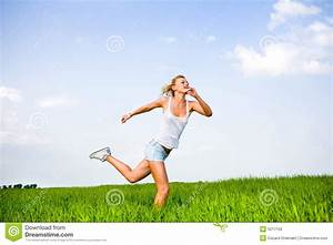 Happy Young Woman Is Running In A Field Royalty Free Stock ...