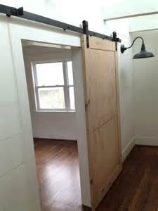 interior sliding barn doors for homes furniture sliding brown wooden and clear glass barn doors with black handle and black metal