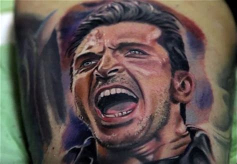 Extra Time Buffon Gets Tattoo Of Fan's Face On His Arm