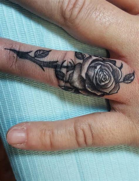 romantic ring finger tattoo ideas