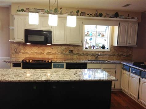 images of kitchens with oak cabinets bianco antico granite countertop color exles 8980