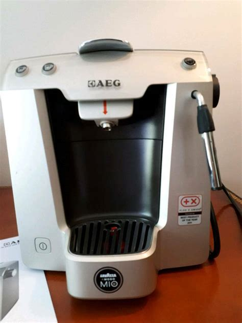 A coffee vending machine in your place of business can save you a lot of money and these days coffee vending machines aren't as complicated as they might seem. LOWER PRICE!! AEG Lavazza Modo Mio coffee machine   in Comely Bank, Edinburgh   Gumtree