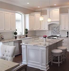 White cabinets, grey granite, white subway backsplash