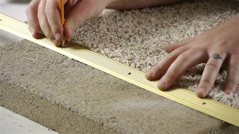 Carpet To Tile Transition On Concrete by How To Install Carpet Transition Trim Between Concrete