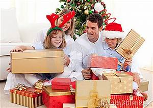 Young Family Having Fun With Christmas Gifts Royalty Free
