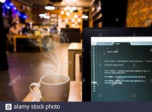 Laptop, With, Programming, Code, And, Coffee, Cup, In, Office, Desk, Low, Depth, Of, Field, Stock, Photo