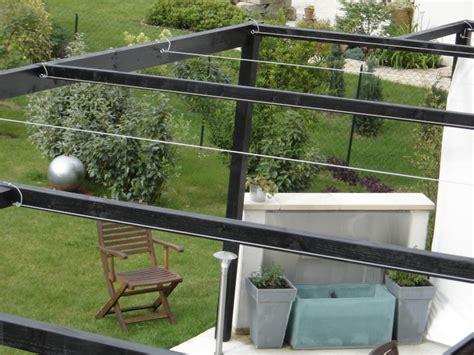 toile d ombrage sur ma terrasse bois