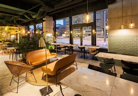 Industrial Style Restaurant With A Greenerythemed Decor