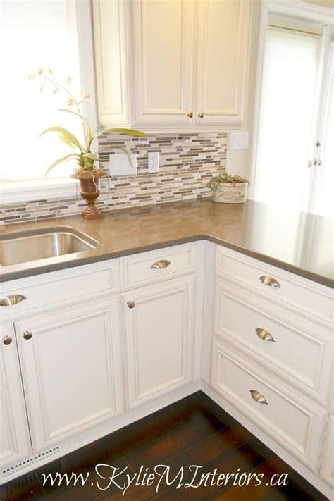 cream backsplash with white cabinets oak kitchen remodel painted cream cabinets and quartz