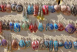 Colourful handmade asian-style earrings on a market stall