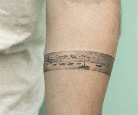 thailand inspired hand poked armband tattoo   left
