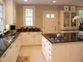 white kitchen cabinets with granite countertop