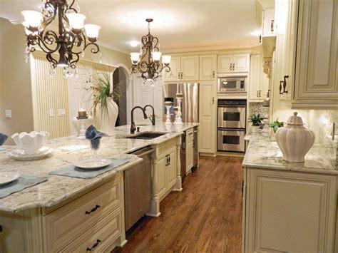 elegant white kitchen  ornate chandeliers hgtv