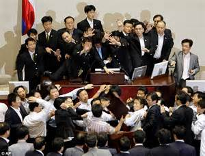 MP sent to hospital as parliament descends into mass brawl