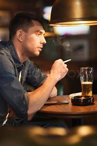 People and bad habits concept - man drinking beer and ...