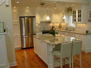 White kitchen cabinets with granite countertops benefits for Kitchen colors with white cabinets with positive wall art