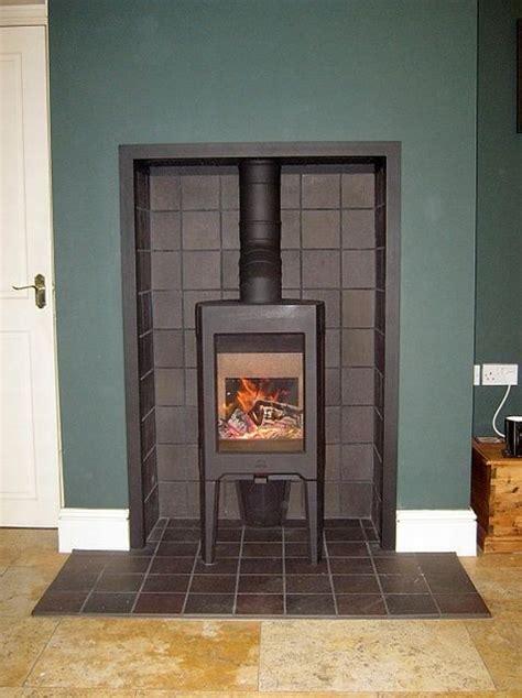 black quarry tiled fireplace  wood burner fireplace