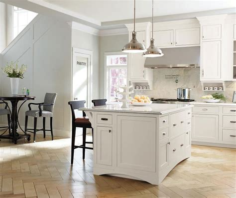 what color kitchen table with white cabinets stacked crown moulding decora cabinetry 9837