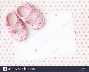 Blank card with baby girl shoes on a pastel pink spotted ...