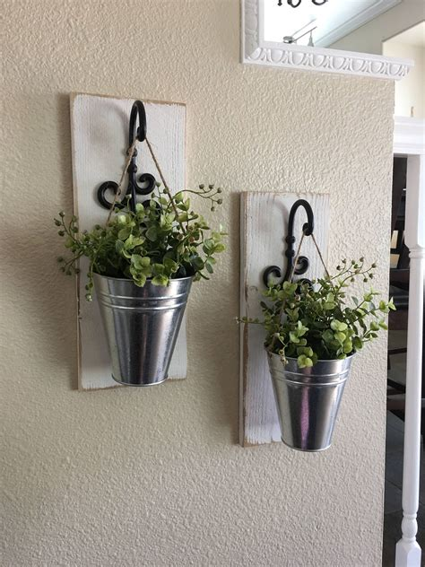 A farmhouse home is also the perfect place for vintage signs and antique fixtures and devices, so think before you discard! Farmhouse Wall Decor, Galvanized Metal Decor, Metal Wall Decor, Sconce with Flowers, Country ...