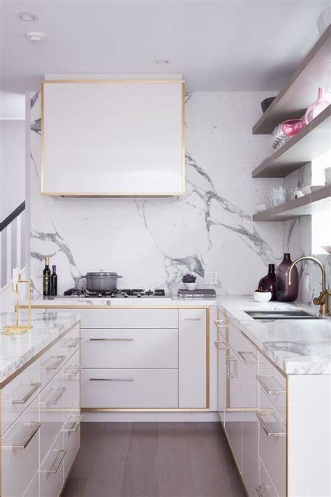 white kitchen cabinets  gold trim contemporary kitchen