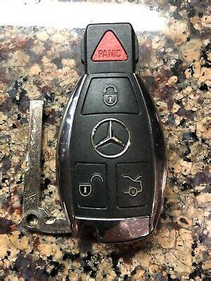 I want a new key for my mercedes benz and i've heard that you can get a used smart key for much cheaper than a new one from a licensed mercedes mechanic. MERCEDES BENZ OEM KEYLESS REMOTE SMART KEY CHROME BLACK TRIANGLE PANIC BUTTON | eBay