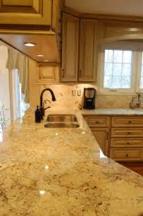Light Color Wood Cabinets with Granite Countertops