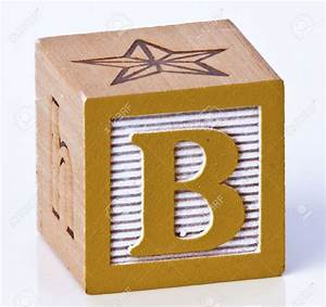 letter wood block used as end table living in a With blocks with letters