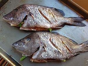Eyeballs and all: grilled whole fish with garlic and ...