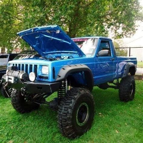 lifted jeep blue lifted blue jeep truck mj with baja lights and winch