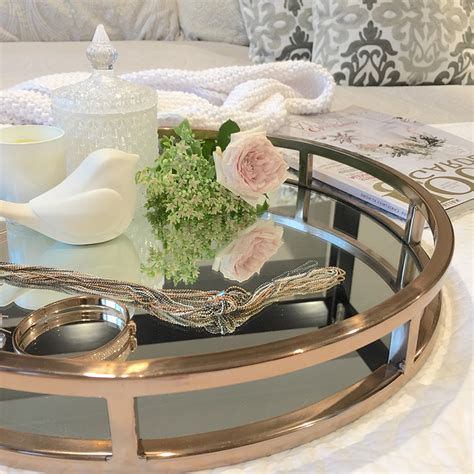 Two reasons why we are obsessed with this understated coffee table. Mirrored Coffee Table Tray   Roy Home Design