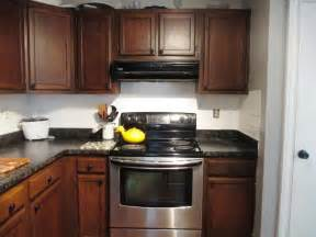 Dark Cabinets And Light Countertops by Restain Oak Kitchen Cabinets Pictures Staining Gallery