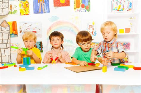 boys learn to use tools as grownups stock photo image 560 | boys learn to use tools as grownups group kids preschool kindergarten age playing plastic classroom 47884345