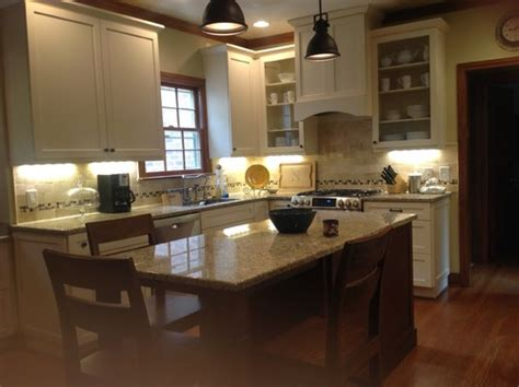 white kitchen cabinets with wood trim should we paint our trim in kitchen den 2094