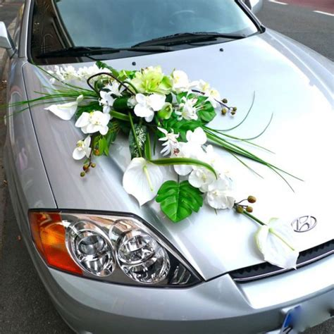wedding car decorated with an artificial silk flower
