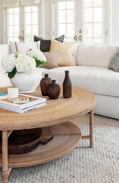 We arrange seating around the coffee table. How to Style a round coffee table - tips and tricks from Studio Mcgee #roundcofe in 2020 | Round ...