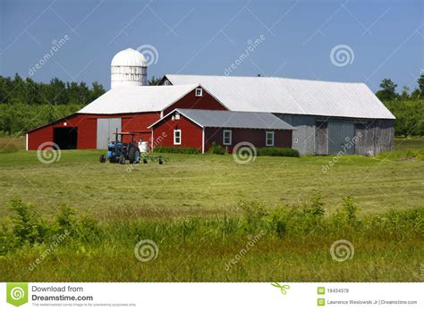Family Barn Farm by American Family Farm Barn And Tractor Stock Photo