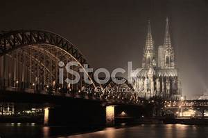 Hohenzollern Brigde And Cologne Cathedral AT Twilight