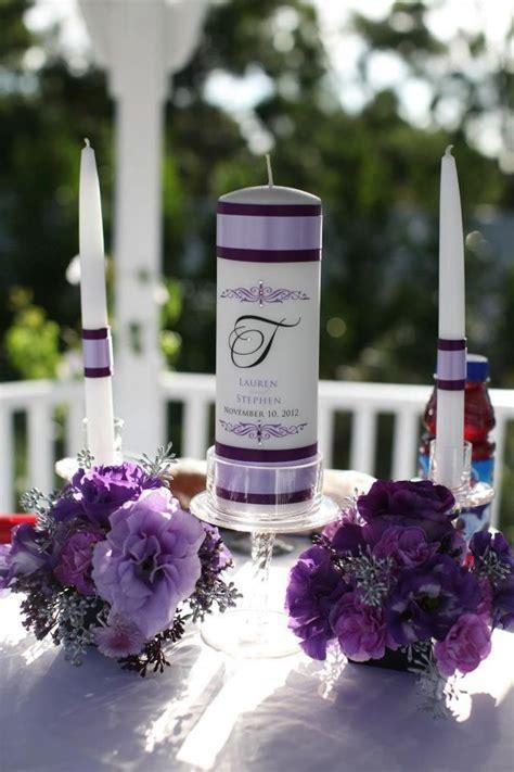 purple wedding unity candles purple flower arrangements