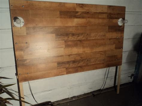 laminate wood flooring headboard my dad and i just finished making this baby out of some spare pieces of hardwood floor some