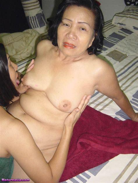 Asian Mature Lesbian Kissing