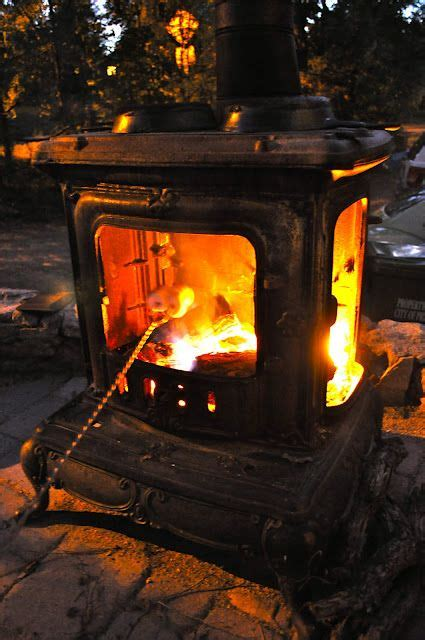 salvaged wood stove   fire pit  fire heats