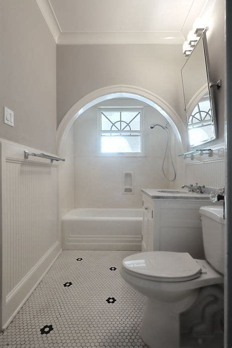 white  gray bathroom features  arched alcove filled