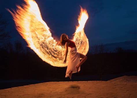 photographer created phoenix wings  light painting