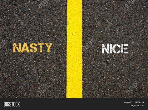Antonym Concept Of Nasty Versus Nice Stock Photo & Stock
