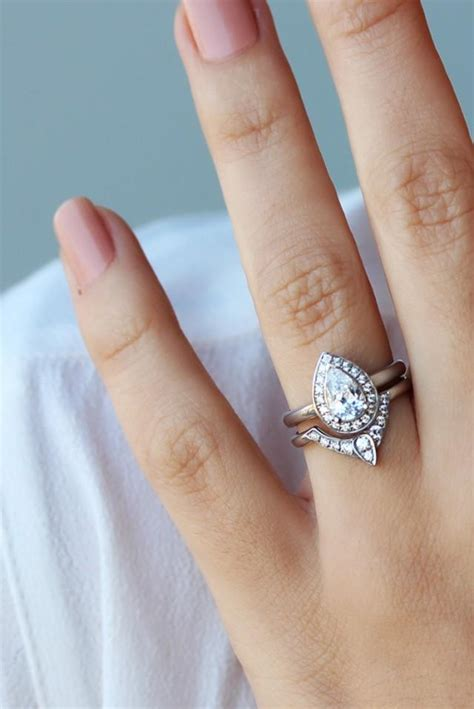 pear shaped diamond engagement ring with matching side